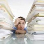 Man Stressed over Book Keeping